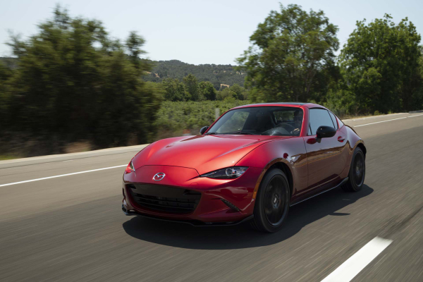 A red mazda mx-5 driving on the open road